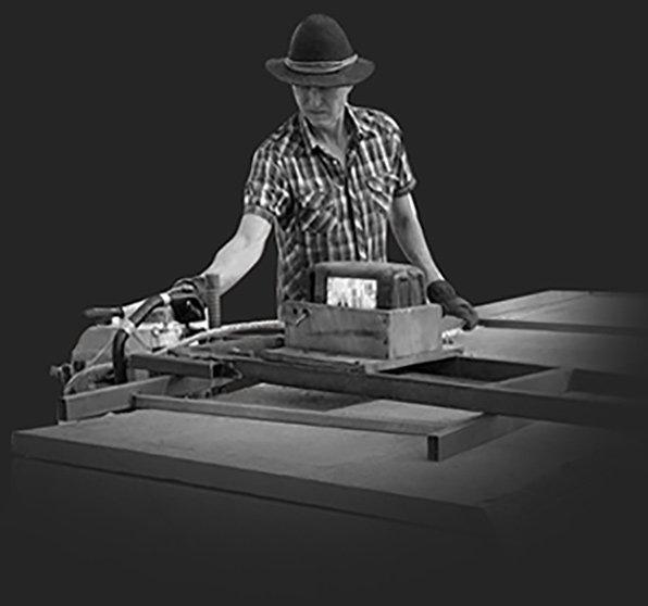 Furniture designer maker Gray Hawk cutting timber in nature